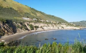 Pirates Cove Beach, just off Highway 1 on California's central coast is a road that takes you through a lush oak valley lined with transformative spas featuring natural, mineral hot springs, world-class massage, yoga instruction, and sense therapies.